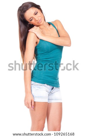 young woman suffering from shoulder pain - stock photo