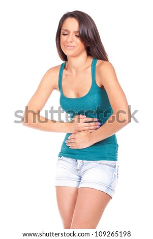 young woman suffering from stomach ache - stock photo