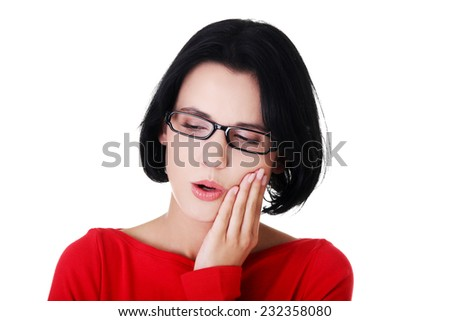 Young woman suffering from toothache. - stock photo