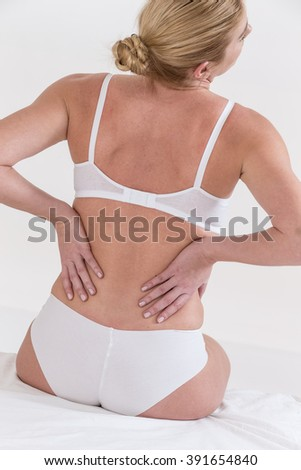 young woman suffering with back ache