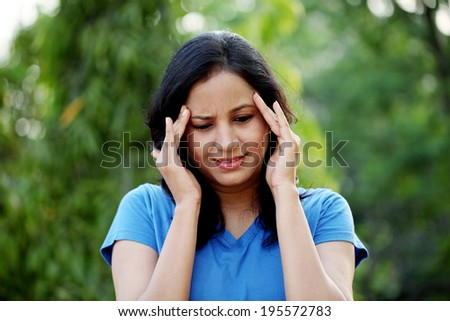 Young woman suffering with headache