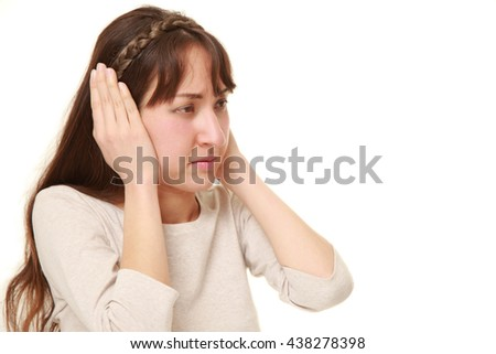 Young woman suffers from noise