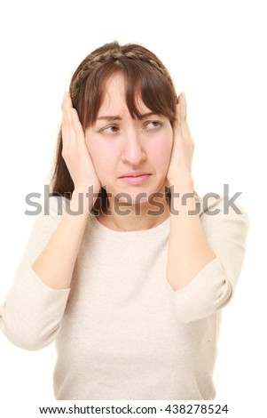 Young woman suffers from noise - stock photo