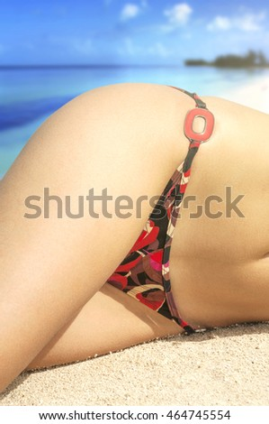 Young woman sunbathing at sea beach