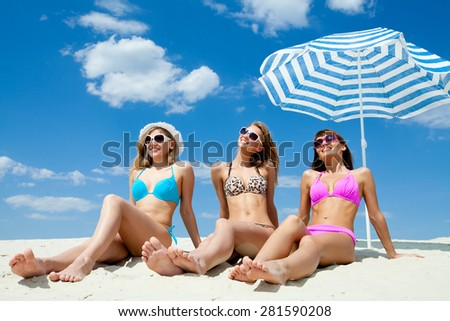 young woman sunbathing  on the sandy  beach - stock photo