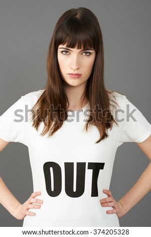 Young Woman Supporter Wearing T Shirt Printed With OUT Slogan - stock photo