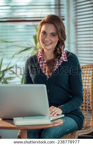 Young woman surfing the net