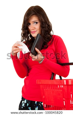 young woman surprised expression looking at store bill, white background