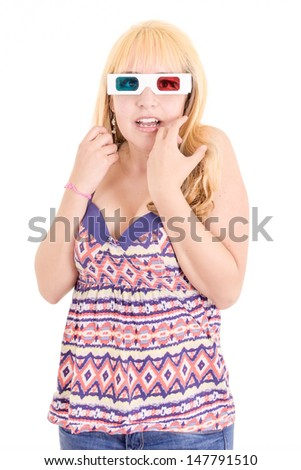 young woman surprised watching TV with 3D glasses