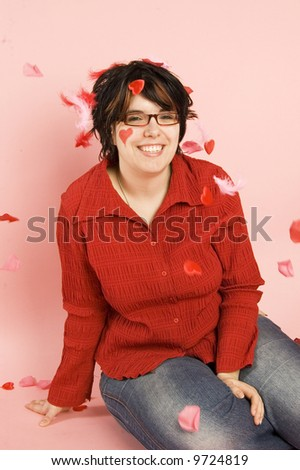 young woman surrounded by hearts and feathers - stock photo