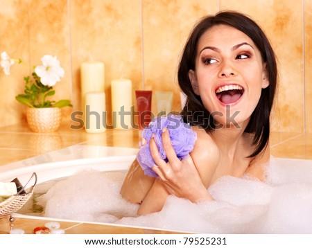 Young woman take bubble  bath. - stock photo