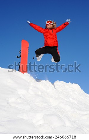 Young woman take fun on the snowboard - stock photo