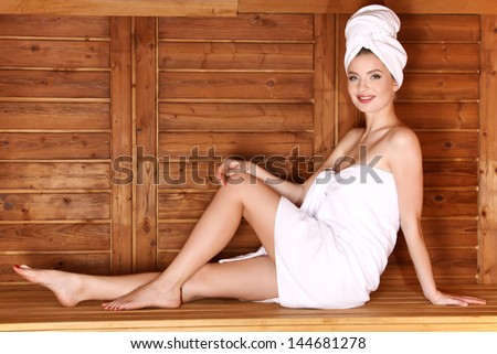 Young woman takes a sauna - stock photo