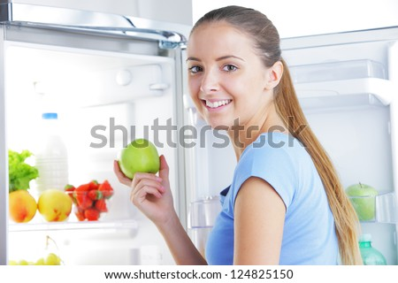 Young woman takes an apple