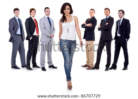 young woman taking a break from her business team and walking towards the camera