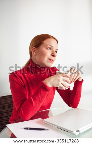 Young woman taking a break from work - stock photo