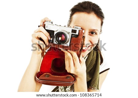 Young woman taking a picture with an old camera. - stock photo