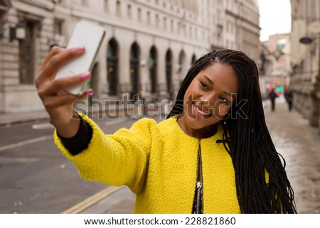 young woman taking a selfie. - stock photo