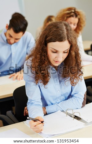 Young woman taking aptitude test in an assessment center