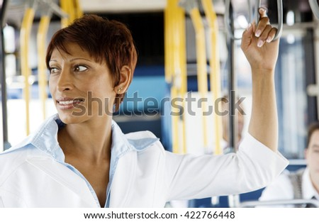 young woman taking bus to work. Urban public transportation concept