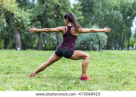 Young woman taking exercises in a park
