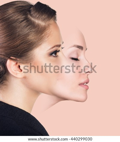 Young woman taking off a mask - stock photo