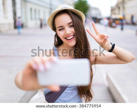 Young woman taking photo - stock photo