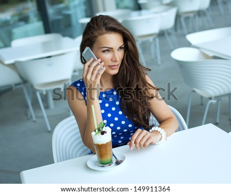 Young woman talking by the smart phone - stock photo