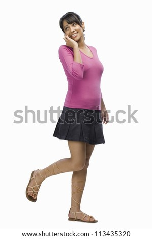 Young woman talking on a mobile phone - stock photo
