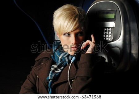Young  woman talking on a phone at night
