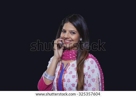 Young woman talking on her mobile phone - stock photo
