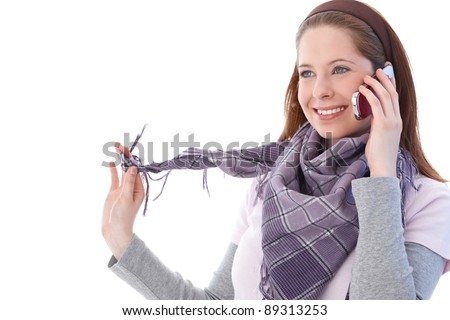 Young woman talking on mobile phone, smiling happily.? - stock photo
