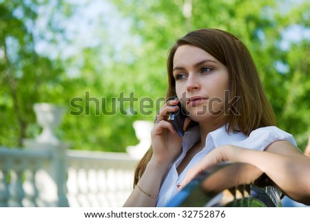 Young woman talking on the mobile phone. - stock photo