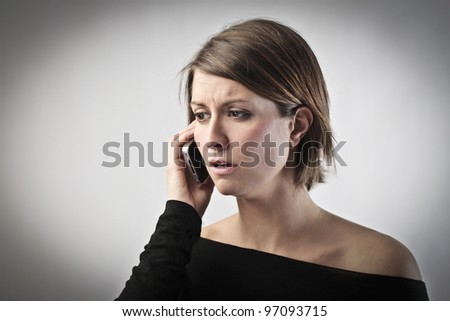 Young woman talking on the mobile phone - stock photo