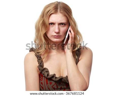Young woman talking on the phone, she is angry and disappointed, isolated on white background - stock photo