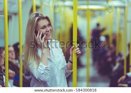 stock photo young woman talking on the phone while commuting by tube train in london beautiful blonde girl 584300818 - Ways to Succeed In A Long Distance Romance