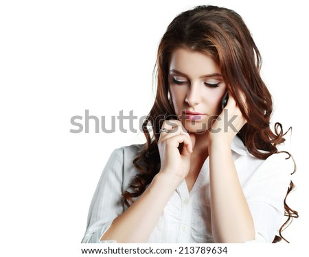Young woman talking seriously or getting bad news by phone. Isolated on white - stock photo