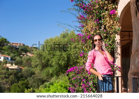 Young woman talking with her phone - stock photo