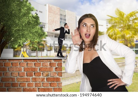 young woman tells a secret - stock photo
