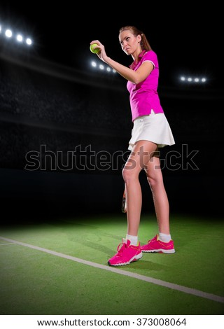 Young woman tennis player on stadium - stock photo