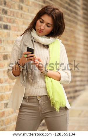 young woman texting her friend - stock photo