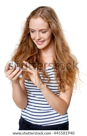 Young woman texting on her cell phone smiling happy - stock photo