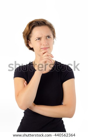 Young Woman Thinking. Hand on Chin. Isolated  - stock photo