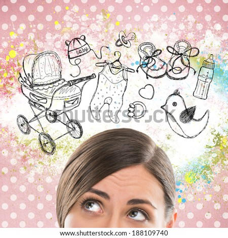 Young woman thinking of her pregnancy plans closeup face portrait and sketches overhead - stock photo