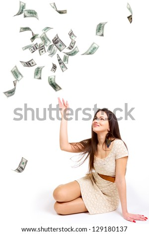 Young woman throwing 100 dollar bills up isolated on white
