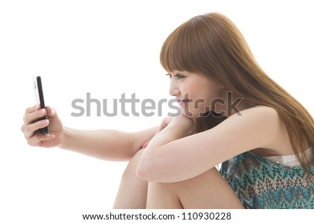Young woman to see a smart phone - stock photo