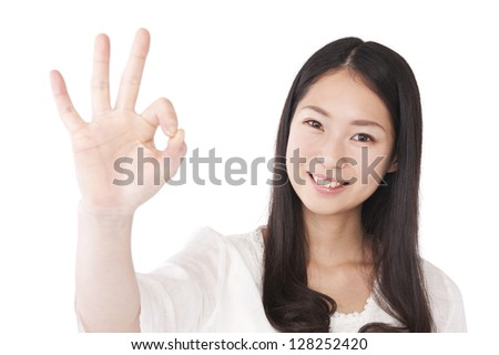 Young woman to the OK sign - stock photo
