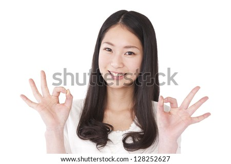 Young woman to the OK sign
