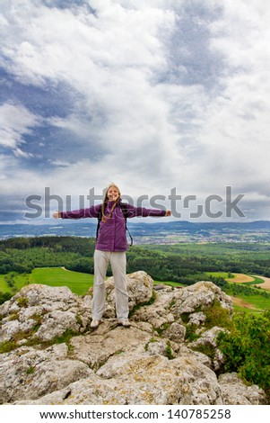 Young woman top of the mountain - stock photo