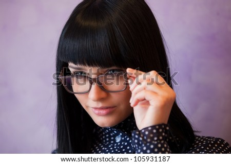 young woman touch her glasses